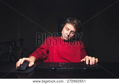 Teen Gamer Sleeps At Home While Playing Video Games. Young Man Uses A Computer And Sleeps. Gamer Con