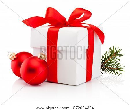 White Gift Box Tied Red Ribbon Bow And Two Christmas Bauble Isolated On White Background