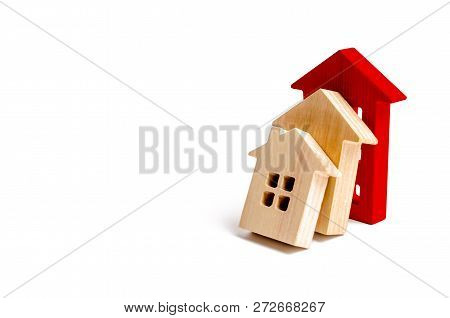 Wooden Houses Fall On Each Other Like Dominoes. The Red House Stops The Fall Of Other Houses. The Co