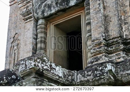 Perspective. Looking Up Into A Doorway Of An Ancient Ruin In Asia
