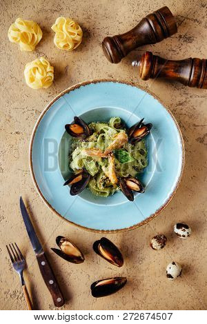 Shellfish Mussels in copper bowl with lemon and herbs. Shellfish seafood. Top view. poster