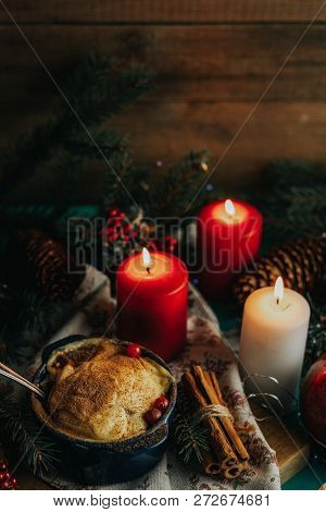 Christmas And New Year Composition With Sweet Delicious Apples Dessert, Spruce Branches, Red Berries