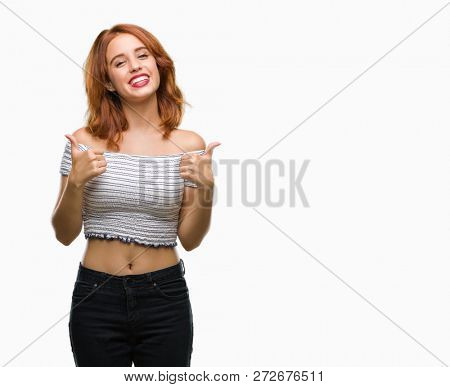Young beautiful woman over isolated background success sign doing positive gesture with hand, thumbs up smiling and happy. Looking at the camera with cheerful expression, winner gesture.