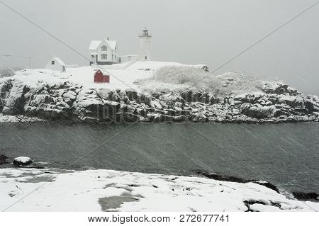 Cape Neddick Lighthouse, Or Also Named As Nubble Light, Its On Island Near Mainland During A Blizzar