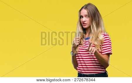 Young beautiful blonde woman over isolated background disgusted expression, displeased and fearful doing disgust face because aversion reaction. With hands raised. Annoying concept.