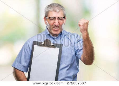 Handsome senior inspector man holding clipboard over isolated background annoyed and frustrated shouting with anger, crazy and yelling with raised hand, anger concept poster