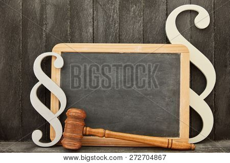 Law law jurassic concept with blank blackboard and judge gavel and paragraph sign