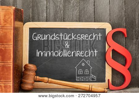 German words Grundstuecksrecht & Immobilienrecht (property law & real estate law) as a concept on a blackboard