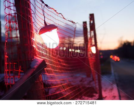 Indicator Light Of Construction Zone On The Road Of The Night City. Warning Signs For Work In Progre