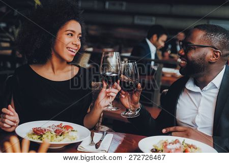 African American Couple Dating In Restaurant. Romantic Couple In Love Dating. Cheerful Man And Woman