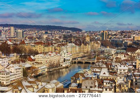 The City Of Zurich In Switzerland As Seen From The Tower Of The Grossmunster Cathedral In Winter. Zu