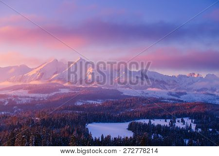 Snowy Mountain Summits In Pink Morning Sunlight. Beautiful Winter Landscape. Tranquil Nature Backgro