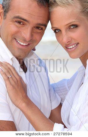 A nice couple by the beach.