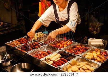 Jiufen, Taiwan - November 6: A Woman Sells Traditional Chinese Snacks At The Street Market Of Jiufen