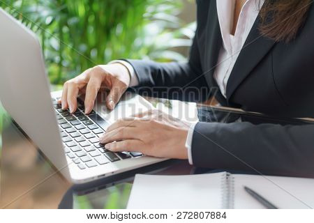 Business Woman Working With Laptop, Copybook And Pen.