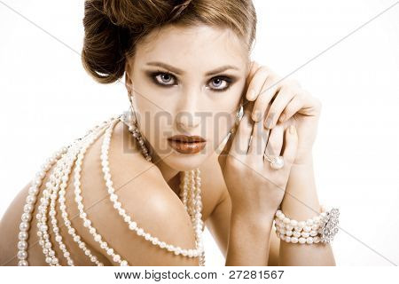 Beautiful young woman wearing jewels in a fashion portrait