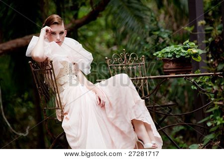 portrait of a beautiful fashion model wearing an elegant dress