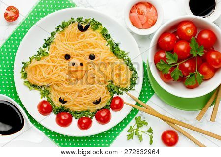 Funny Yellow Chick From Rice Noodles With Green Onion And Cherry Tomatoes For Healthy Kids Lunch