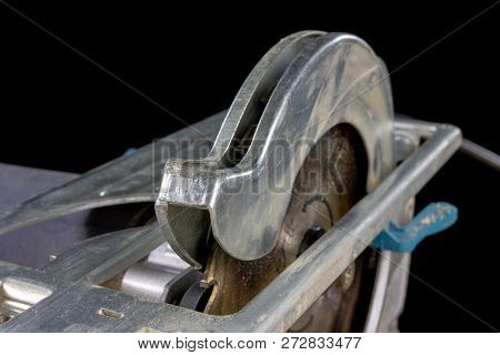 Circular Saw On A Workshop Table. Tools For A Carpenter In A Home Workshop.