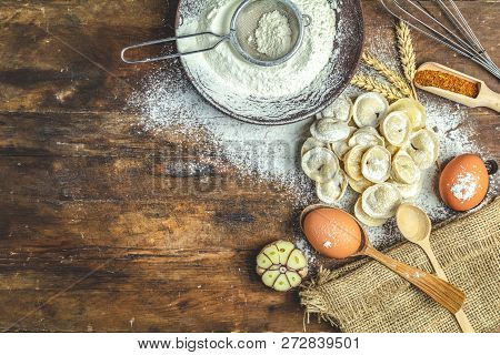 Raw Homemade Delicious Traditional Italian Ravioli, Dumplings With Meat And Set Ingredients On Dark