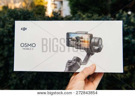 Paris, France - Nov 22, 2018: Man Hand Holding In Outdoor Background New Dji Osmo Mobile 2 Smartphon