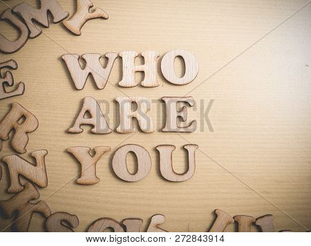 Who Are You In Wooden Words Letter, Motivational Self Development Business Typography Quotes Concept