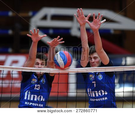 KAPOSVAR, HUNGARY – NOVEMBER 29, 2018: Cameron Keen (blue 13) in action at a Hungarian National Cup volleyball game between Kaposvar (blue) and MAV Elore (white) in Sportcsarnok Kaposvar.
