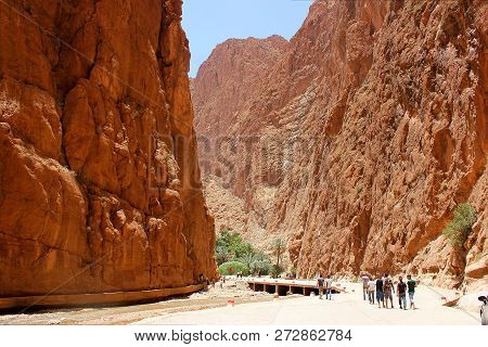 Todra, Morocco - June 28, 2014: Unidentified Tourists  In A Canyon In Morocco. Todra Gorge Is A Cany