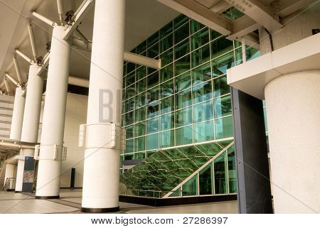 Modern architecture with glass in outside, train station.
