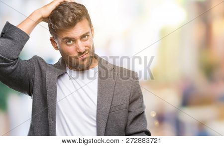 Young handsome business man over isolated background confuse and wonder about question. Uncertain with doubt, thinking with hand on head. Pensive concept.