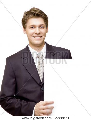 Young Smiling Businessman Holding A Blank Cardboard