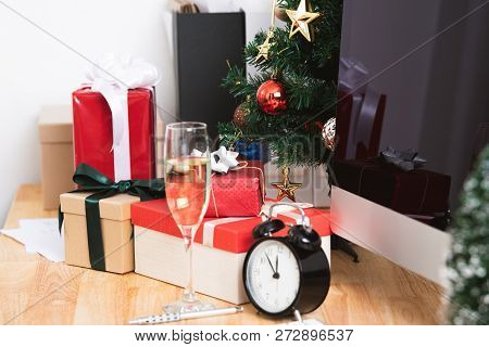 Red Gift Box In Christmas Holiday At The Office With Christmas Decoration On Table.