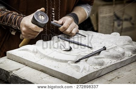 Carving Stone In A Traditional Way