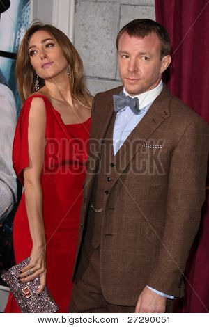 LOS ANGELES - DEC 6:  Jacqui Ainsley, Guy Ritchie arrives at the