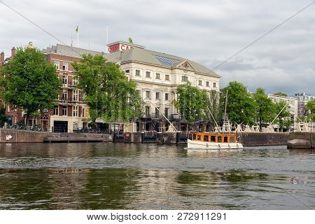 Amsterdam, The Netherlands - June 19, 2018: View From River Amstel At Exterior Of Royal Theater Carr