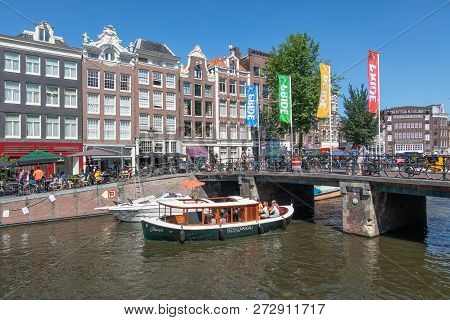 Amsterdam, The Netherlands - August 03, 2018: Tourists Making A Sightseeing Trip By Launch Ship In A