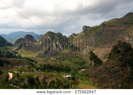View Onto A Valley With Limestone Mountains In Northern Vietnam