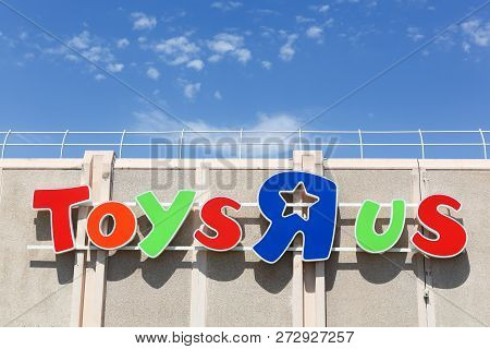 Lattes, France - July 5, 2018: Logo Of The Brand Toys R Us On A Wall. Toys R Us Is An American Toy A