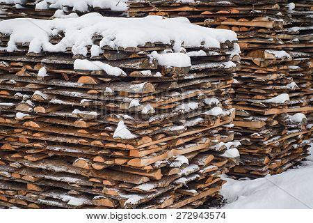 Stack Of Cut Wood Under The Snow,woodpile Stacked Of Firewood Under The Snow.
