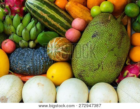 Natural Tropical Fruit Vibrant Background. Raw And Ripe Exotic Fruit Closeup Photo. Colorful Vegetar