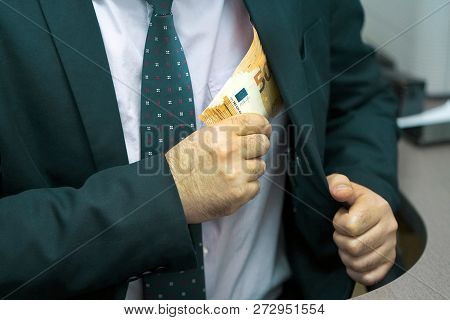 A Businessman Gives Euro A Bribe To An Employee In The Office. Concept - Corruption. Giving A Bribe.