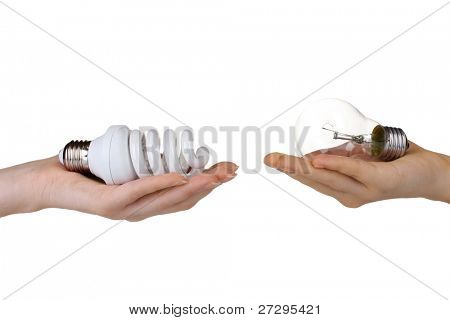Woman's hand offering ordinary light bulb and the other woman's hand offering energy-saving lamp