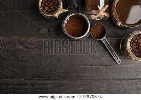 Preparation Of Coffee, Ground Coffee, Coffee Beans, On A Dark Background, Top View With Empty Space