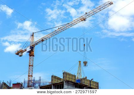Construction of a multi-storey building with a monolithic frame construction, the process of supplying concrete for pouring walls in formwork. poster