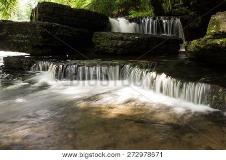 A Series Of Small Waterfalls In A Forest.  Old Stone Fort State Archaeological Park, Manchester, Tn,