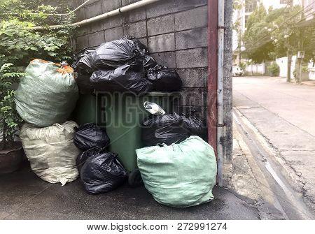 Garbage Is Pile Lots Dump, Many Garbage Plastic Bags Black Waste At Walkway Community Village, Pollu