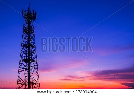 Silhouette In A Large Transmission Tower At Sunset Beautiful.