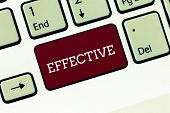 Handwriting text Effective. Concept meaning successful in producing desired or intended result productive Keyboard key Intention to create computer message, pressing keypad idea. poster