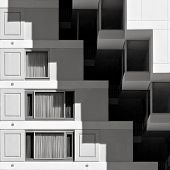 An abstract black and white photo of modern/postmodern hotel architeture. poster