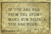 If you are far from the enemy, make him believe you are near - ancient Chinese strategist ond writer Sun Tzu quote printed on grunge vintage cardboard poster